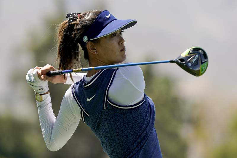 FILE - In this April 5, 2019, file photo, Michelle Wie watches her tee shot on the 18th hole during the second round of the LPGA Tour ANA Inspiration golf tournament at Mission Hills Country Club in Rancho Mirage, Calif. New mom Michelle Wie West is looking forward to being nervous again on the golf course. It's been nearly two years since Wie West last played a competitive round on the LPGA Tour, and nine months since she gave birth to daughter Makenna. (AP Photo/Chris Carlson, File)