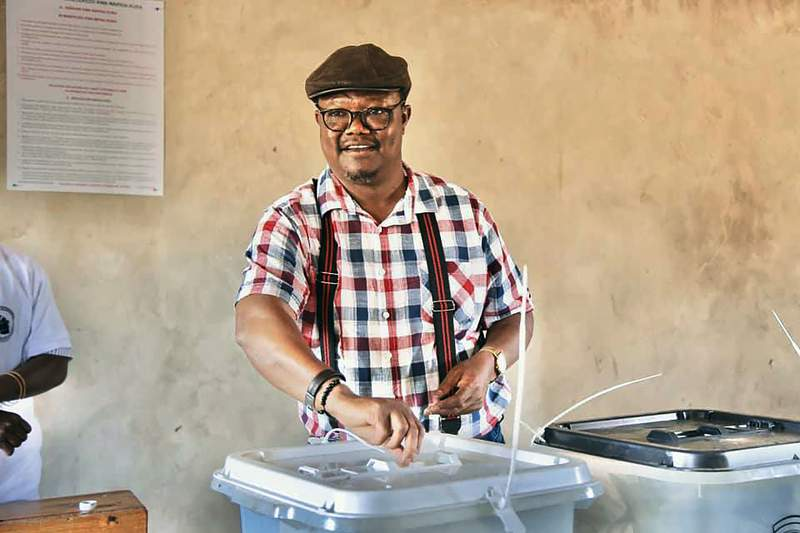 Chadema Presidential Candidate Tundu Lissu casts his vote at Ntewa Primary School's polling station in Ikungi town Singida region, Tanzania, Wednesday. Oct.28, 2020. Opposition challenger Lissu has urged people to go into the streets to protest if election results are announced Thursday without being counted properly. (AP Photo)