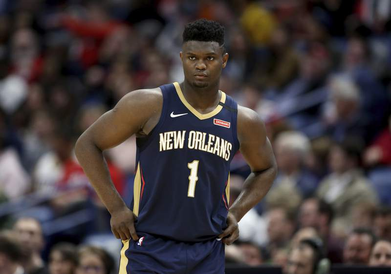 FILE - In this March 6, 2020, file photo, New Orleans Pelicans forward Zion Williamson walks onto the court during the second half of the team's NBA basketball game against the Miami Heat in New Orleans. A Florida appeals court has granted Williamsons motion to block his former marketing agents effort to have the ex-Duke star answer questions about whether he received improper benefits before playing for the Blue Devils. The order Wednesday shifts the focus to separate but related case between the same litigants in federal court in North Carolina. (AP Photo/Rusty Costanza, File)