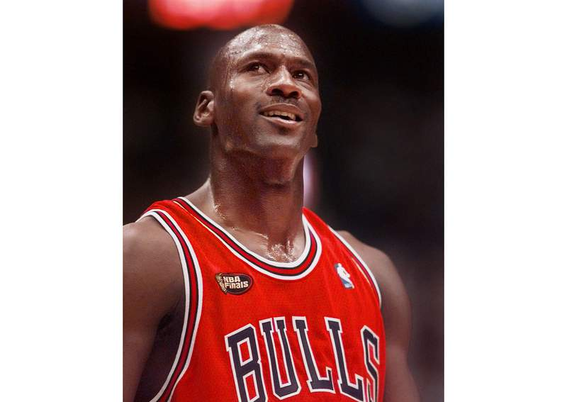 FILE -This June 14, 1998 file photo shows Chicago Bulls' Michael Jordan looking up at the score during the third quarter of their NBA Finals game against the Utah Jazz in Salt Lake City. The Last Dance, ESPNs docuseries detailing the 1998 and final season of the Chicago Bulls championship dynasty, has served as a reminder to basketball fans of the greatness of Michael Jordan on the court. It also shed light on his worldwide marketing allure. (AP Photo/Mark J. Terrill, File)