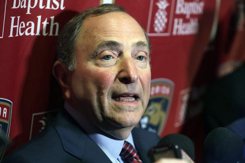 FILE - National Hockey League Commissioner Gary Bettman speaks to members of the media , Saturday, March 7, 2020, in Sunrise, Fla. The National Hockey League will be returning to ESPN beginning next season. People familiar with the deal say the two sides have reached agreement on a seven-year contract that will include four Stanley Cup finals. (AP Photo/Wilfredo Lee, file)