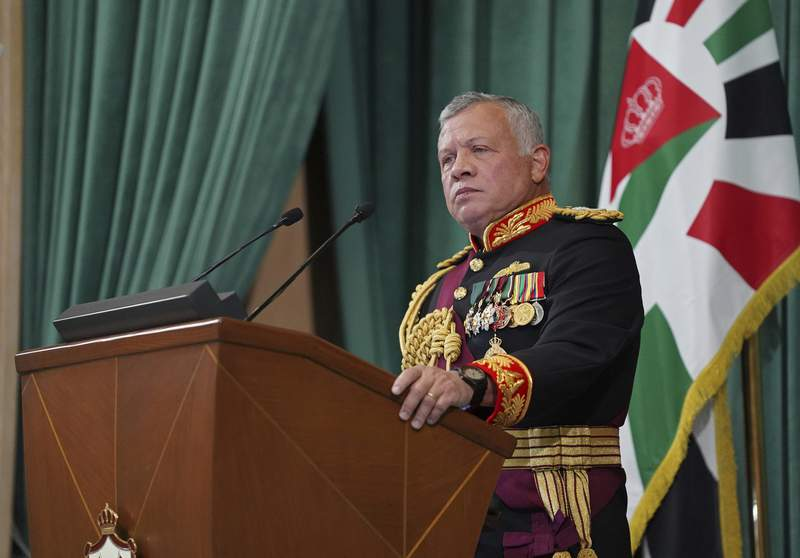 FILE - In this Dec. 10, 2020  photo released by the Royal Hashemite Court, Jordan's King Abdullah II gives a speech during the inauguration of the 19th Parliament's non-ordinary session, in Amman Jordan.  Jordans army chief of staff says the half-brother of King Abdullah II was asked to stop some movements and activities that are being used to target Jordans security and stability. The army chief of staff denied reports Saturday, April 3, 2021, that Prince Hamzah was arrested. He said an investigation is still ongoing and its results will be made public in a transparent and clear form.   (Yousef Allan/The Royal Hashemite Court via AP, File)