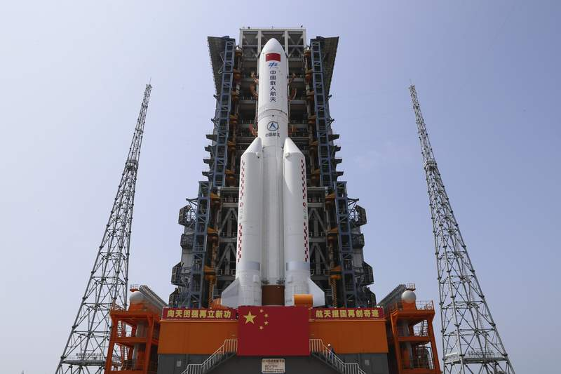 In this photo released by Xinhua News Agency, the core module of China's space station, Tianhe, on the the Long March-5B Y2 rocket is moved to the launching area of the Wenchang Spacecraft Launch Site in southern China's Hainan Province on April 23, 2021. China plans to launch the core module for its first permanent space station this week in the latest big step forward for the countrys space exploration program. The Tianhe, or Heavenly Harmony  module is set to be hurtled into space aboard a Long March 5B rocket from the Wenchang Launch Center on the southern island of Hainan. The launch could come as early as Thursday night, April 29, 2021 if all goes as planned.  (Guo Wenbin/Xinhua via AP)