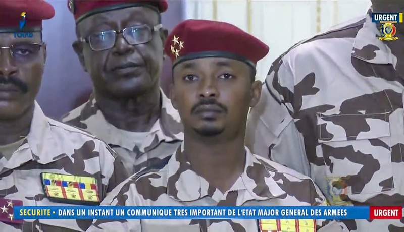 """Mahamat Idriss Deby Itno, 37, the son of Chadian President Idriss Deby Itno, is seen during a military broadcast announcing the death of his father on state television Tuesday, April 20, 2021. Deby, who ruled the central African nation for more than three decades, was killed on the battlefield Tuesday, April 20, 2021 in a fight against rebels, the military announced on national television and radio. Onscreen writing in French reads """"Security - In a moment a very important communique from the General Staff of the Military - Urgent"""". (Tele Tchad via AP)"""