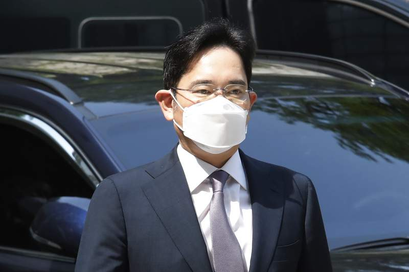 FILE - In this June 8, 2020 file photo, Samsung Electronics Vice Chairman Lee Jae-yong arrives at the Seoul Central District Court in Seoul, South Korea. Prosecutors on Tuesday indicted Samsung heir Lee on charges of stock-price manipulation and other financial crimes, setting up what could become a yearslong legal battle to determine whether the 52-year-old billionaire illegally cemented his control over the business giant. (AP Photo/Ahn Young-joon, File)