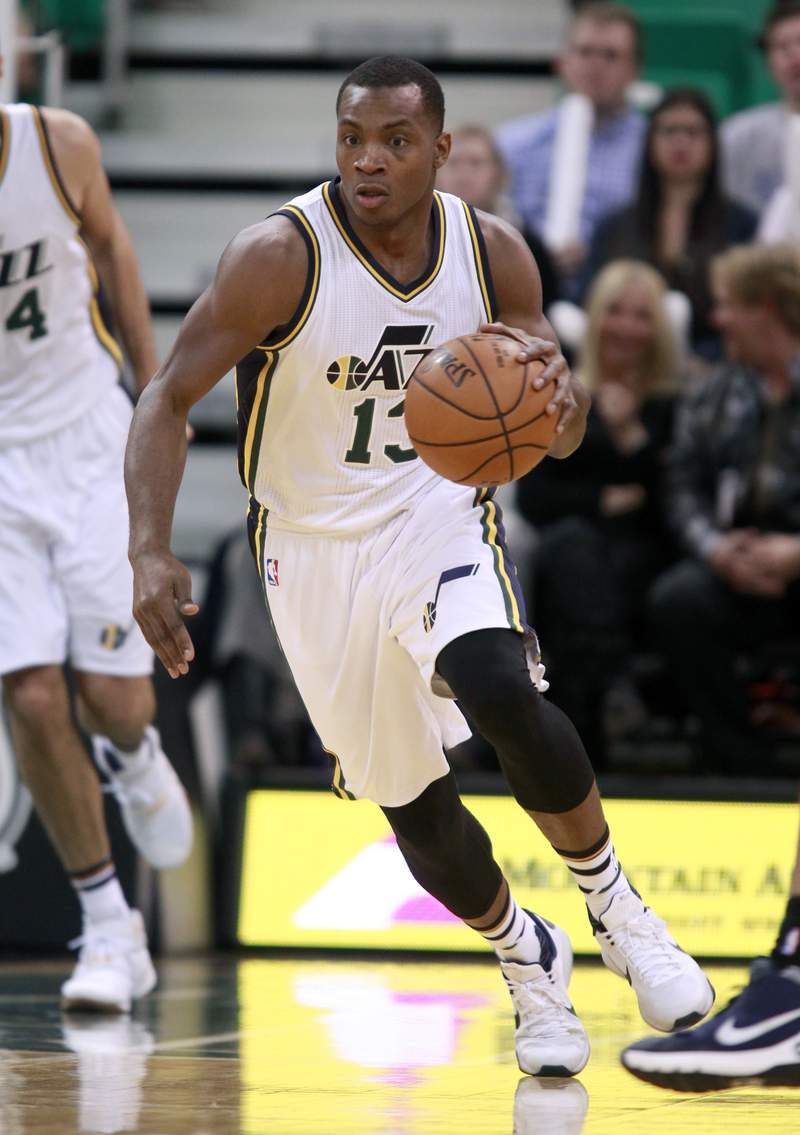 FILE - In this Nov. 23, 2015, file photo, Utah Jazz guard Elijah Millsap brings the ball downcourt against the Oklahoma Thunder in the second half during an NBA basketball game in Salt Lake City.  Former Jazz player Millsap alleged this week that Utah executive Dennis Lindsey made a bigoted comment to him in 2015. The Jazz and the NBA are investigating. (AP Photo/George Frey, File)