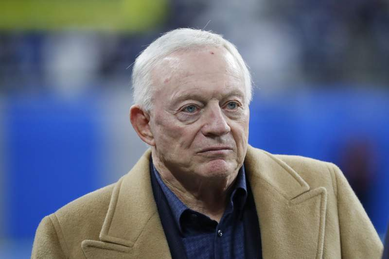 FILE - In this Nov. 17, 2019, file photo, Dallas Cowboys owner and general manager Jerry Jones waits for the team's NFL football game against the Detroit Lions in Detroit. Jones sidestepped the question of whether he would change his policy requiring players for the Cowboys to stand during the national anthem. Still, the owner who has taken the hardest line among his NFL counterparts against protesting racial injustice during The Star-Spangled Banner did acknowledge a changing social tide after the killing of George Floyd by police in Minneapolis. (AP Photo/Paul Sancya, File)