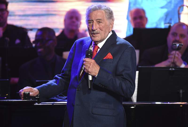 FILE - Tony Bennett performs at the Statue of Liberty Museum opening celebration on May 15, 2019, in New York. Bennett has canceled his fall and winter 2021 tour dates. The legendary crooner is pulling out of concerts in New York, Maryland, Connecticut, Arizona, Oklahoma and Canada. Ticket holders should check with the local venues for information regarding refunds. (Photo by Evan Agostini/Invision/AP, File)