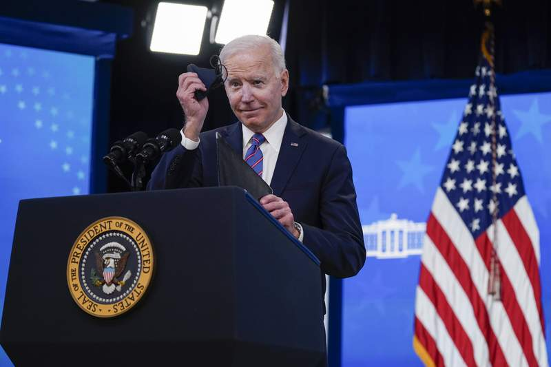 President Joe Biden holds a face mask as he speaks during an event to mark Equal Pay Day in the South Court Auditorium in the Eisenhower Executive Office Building on the White House Campus Wednesday, March 24, 2021, in Washington. (AP Photo/Evan Vucci)
