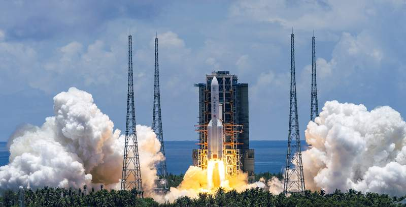 FILE - In this  July 23, 2020, file photo released by China's Xinhua News Agency, a Long March-5 rocket carrying the Tianwen-1 Mars probe lifts off from the Wenchang Space Launch Center in southern China's Hainan Province. China's Mars probe Tianwen-1, which blasted into space in July, is now more than 15 million kilometers (9 million miles) from Earth en route to the red planet, the National Space Administration said Saturday, Sept. 12, 2020. (Cai Yang/Xinhua via AP)
