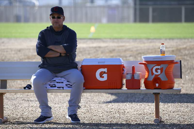 FILE - Cleveland Indians manager Terry Francona looks on during spring training baseball workouts for pitchers and catchers in Avondale, Ariz., in this Thursday, Feb. 13, 2020, file photo. Indians manager Terry Francona recently underwent surgery for a staph infection in his toe and will be on crutches for several weeks in training camp. Francona said Friday, Feb. 19, 2021, that he was being treated for gout this winter when doctors discovered the infection, which was excised. He spent 10 days in the Cleveland Clinic before returning to Arizona.(AP Photo/Ross D. Franklin, File)