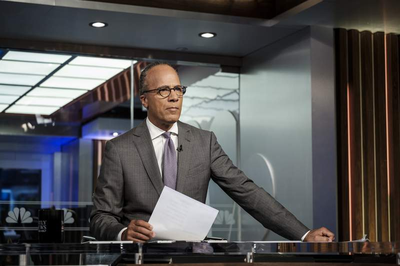 NBC's Lester Holt appears on the set in New York on Tuesday Aug. 7, 2018. The NBC Nightly News anchor occasionally ends his broadcasts now with commentaries, an unusual departure for network evening newscasts that have a lengthy track record of playing it straight. Holt's commentaries trend toward the non-controversial, with a central theme of trying to find common ground that will pull Americans together.  (Christopher Dilts/NBC Universal via AP)