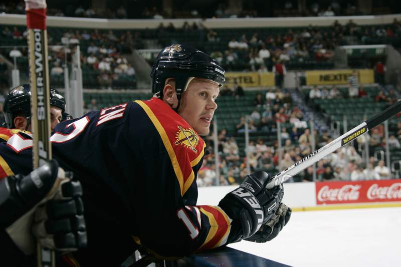 Olli Jokinen of the Florida Panthers looks on from the bench against the Boston Bruins during the NHL game on October 13, 2005 at the Bank Atlantic Center in Sunrise, Florida.