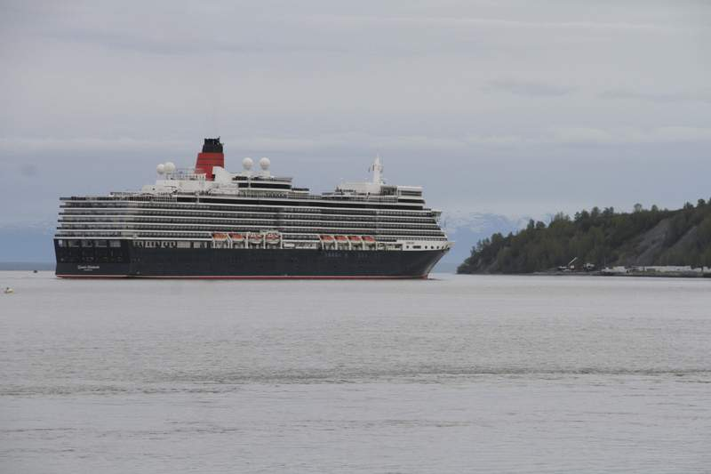 FILE - The Cunard cruise ship Queen Elizabeth sails through Cook Inlet Thursday, May 16, 2019, for a port call in Anchorage, Alaska. Federal officials say a lawsuit in Florida could block cruise ships from visiting Alaska in summer 2021. (AP Photo/Mark Thiessen, File)