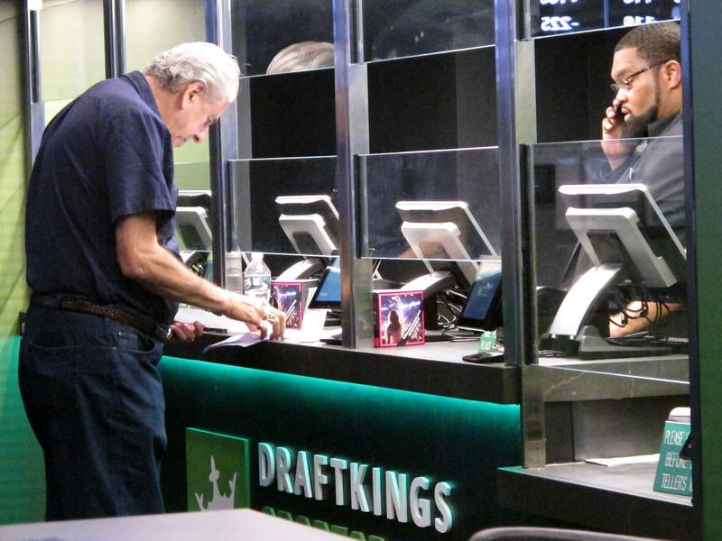 FILE - In this Oct. 8, 2019 file photo a gambler makes a sports bet at Resorts casino in Atlantic City, N.J. On Sunday, April 25, 2021, British gambling company Super Group announced a deal to become publicly traded and enter the U.S. sports betting market, including New Jersey. (AP Photo/Wayne Parry, File)