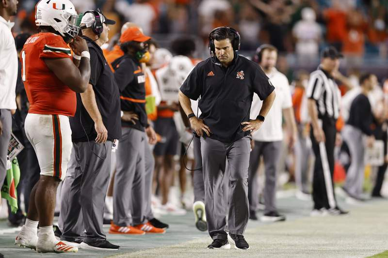 Head coach Manny Diaz of the Miami Hurricanes reacts against the Virginia Cavaliers during the second half at Hard Rock Stadium on September 30, 2021 in Miami Gardens, Florida.