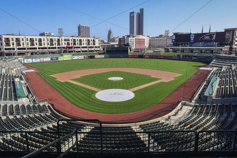 FILE - In this April 8, 2020, file photo, an empty Parkview Field minor league baseball stadium is shown in downtown Fort Wayne, Ind. Unlike the NFL, NBA or Major League Baseball that can run on television revenue, it's impossible for some minor sports leagues in North America to go on in empty stadiums and arenas in light of the coronavirus pandemic. These attendance-driven leagues might not play again at all in 2020, putting some teams in danger of surviving at all and potentially changing the landscape of minor league sports in the future. (Mike Moore/The Journal-Gazette via AP, File)