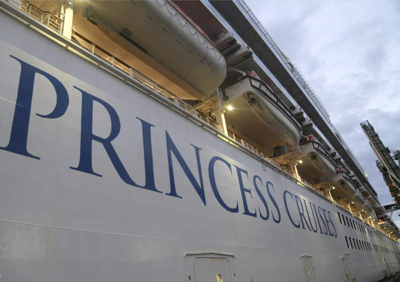 In this photo provided by the New South Wales Police, the Ruby Princess cruise ship is docked in Wollongong, Australia, on April 8. Police wearing protective gear boarded the cruise ship to seize evidence and question crew members after the vessel was linked to hundreds of COVID-19 cases and more than a dozen deaths across Australia.