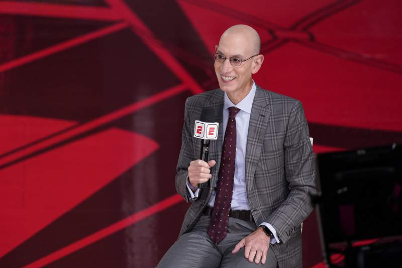 File-This Oct. 4, 2020, file photo shows NBA Commissioner Adam Silver speaking during an interview before the NBA Finals in Lake Buena Vista, Fla. The NBA has informed teams that it intends to return to a normal schedule next season, with training camps opening in late September and the regular season set to begin on Oct. 19., 2021. It is not an unexpected development, and Silver has said several times that the leagues intention for the past several months, virus-permitting, was to get the league back onto its regular calendar after two seasons of schedule havoc because of the pandemic. (AP Photo/Mark J. Terrill, File)