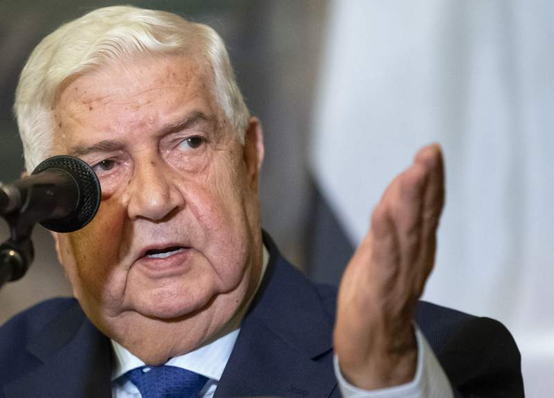 FILE - In this Aug. 30, 2018, file photo, Syrian Foreign Minister Walid al-Moallem gestures as he speaks to the media in Moscow, Russia. Al-Moallem, a career diplomat who became one of the country's most prominent faces to the outside world during the uprising against Syria's President Bashar Assad, died Monday, Nov. 16, 2020. He was 79. (AP Photo/Alexander Zemlianichenko, File)