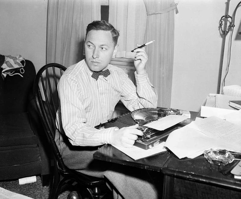 FILE - This Nov. 11, 1940 file photo shows playwright Tennessee Williams at his typewriter in New York. A rarely seen Williams short story The Summer Woman appears in the fall issue of the literary quarterly The Strand Magazine. (AP Photo/Dan Grossi, File)