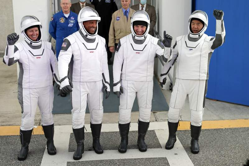 NASA astronauts, from left, Shannon Walker, Victor Glover, and Michael Hopkins and Japan Aerospace Exploration Agency astronaut Soichi Noguchi leave the Operations and Checkout Building on their way to launch pad 39A for the SpaceX Crew-1 mission to the International Space Station at the Kennedy Space Center in Cape Canaveral, Fla., Sunday, Nov. 15, 2020. (Photo/John Raoux)