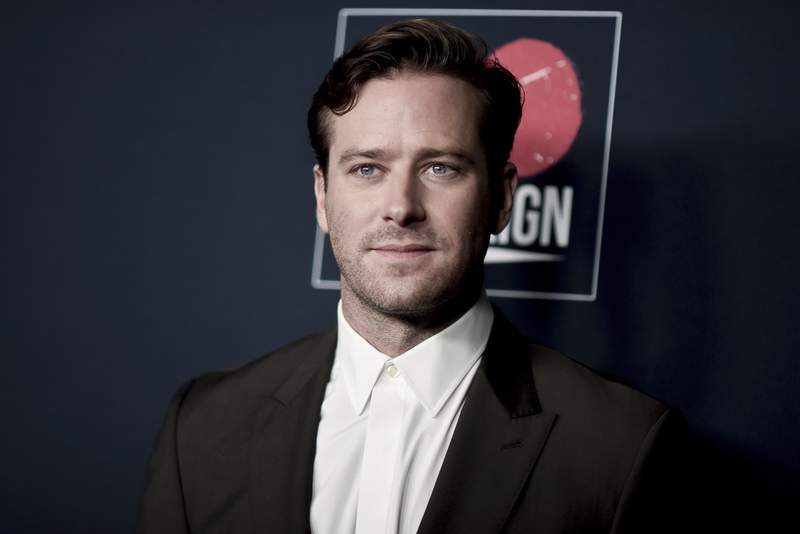 FILE - Armie Hammer attends the 13th Annual Go Gala on Nov. 16, 2019, in Los Angeles. Los Angeles police said Thursday, March 18, 2021, that they are investigating actor Armie Hammer for sexual assault. His attorney denies the allegation. A police spokesman says Hammer is the main suspect in an incident reported on Feb. 3. (Photo by Richard Shotwell/Invision/AP, File)