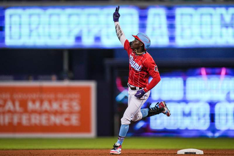 Jazz Chisholm Jr. of the Miami Marlins hold up the peace sign while running the bases after hitting a solo homerun in the sixth inning against the Chicago Cubs at loanDepot park on August 15, 2021 in Miami, Florida.