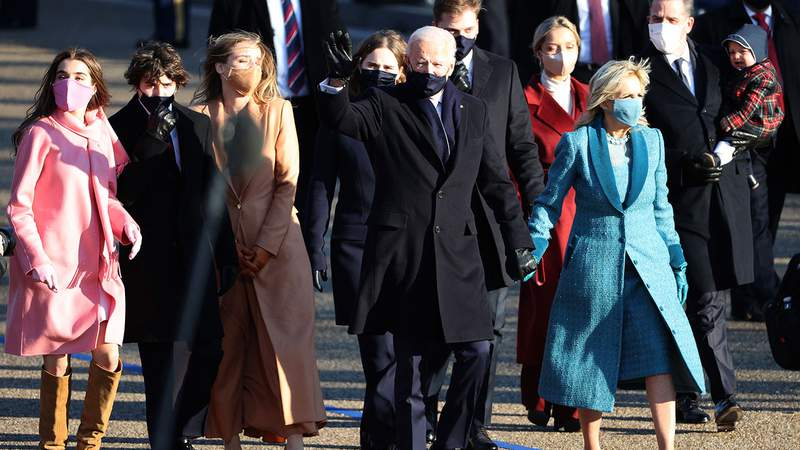 President Joe Biden and First Lady Dr. Jill Biden and family walk the abbreviated parade route after Biden's inauguration on January 20, 2021 in Washington, DC. Biden became the 46th president of the United States earlier today during the ceremony at the U.S. Capitol.