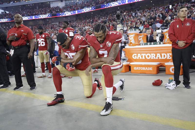 FILE - In this Sept. 12, 2016, file photo, San Francisco 49ers safety Eric Reid (35) and quarterback Colin Kaepernick (7) kneel during the national anthem before an NFL football game against the Los Angeles Rams in Santa Clara, Calif. When Colin Kaepernick took a knee during the national anthem to take a stand against police brutality, racial injustice and social inequality, he was vilified by people who considered it an offense against the country, the flag and the military. Nearly four years later, it seems more people are starting to side with Kaepernicks peaceful protest and now are calling out those who dont understand the intent behind his action.  (AP Photo/Marcio Jose Sanchez, File)
