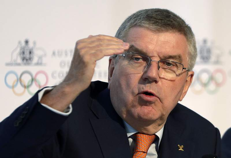 FILE - In this May 4, 2019, file photo, International Olympic Committee President Thomas Bach speaks at the Australian Olympic Committee annual general meeting in Sydney, Australia. During an interview with a German newspaper Sunday, April 12, 2020, Bach says the International Olympic Committee will face several hundred million dollarsof added costs because of the postponement of the Tokyo Olympics until next year. (AP Photo/Rick Rycroft, File)