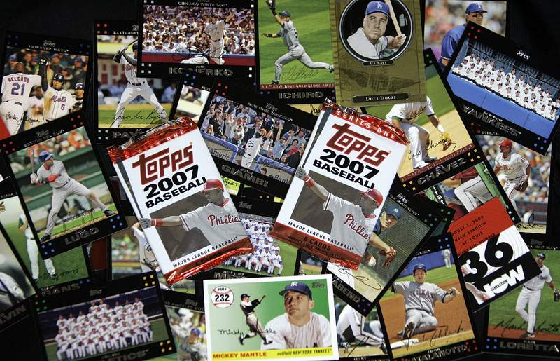 FILE - In this March 6, 2007 file photo, Topps baseball cards are seen in Boston.  Major League Baseball is ending its 70-year relationship with trading card company Topps, Thursday, Aug. 19, 2021, and will instead be working sports merchandise company Fanatics.   (AP Photo/Chitose Suzuki, file)