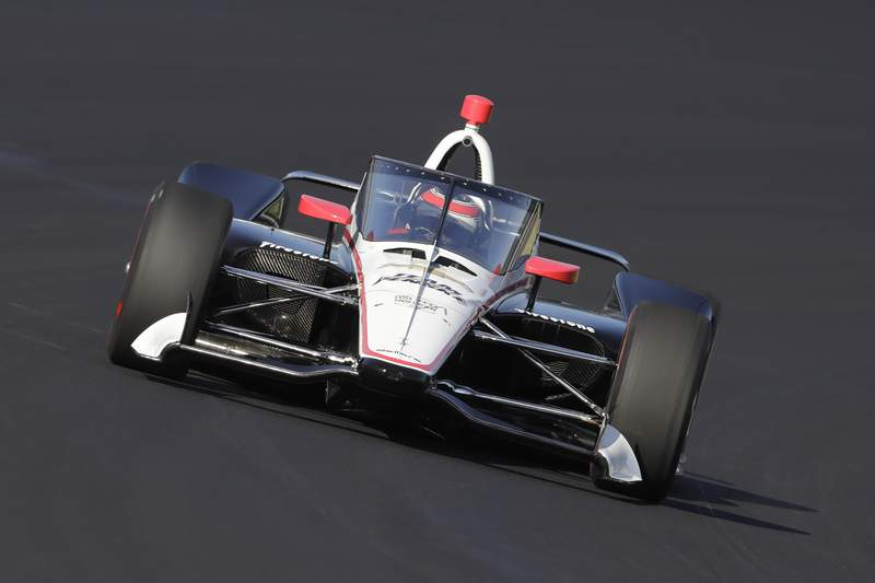 FILE - In this Wednesday, Oct. 2, 2019, file photo, Will Power, of Australia, drives into turn one during the Aeroscreen testing at Indianapolis Motor Speedway in Indianapolis. After 10 months of testing, the canopy-shaped cockpit protection is intended to protect the driver from debris. (AP Photo/Darron Cummings, File)