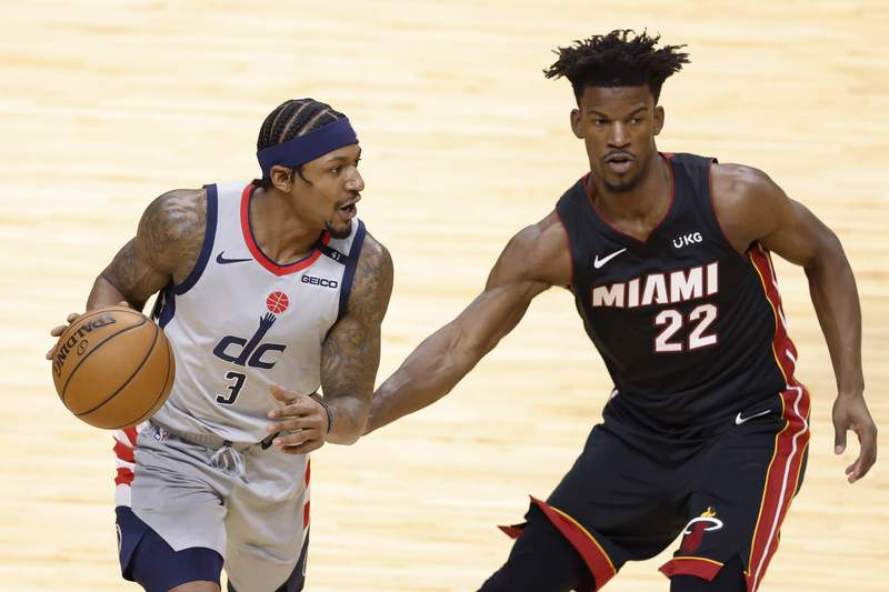 Bradley Beal of the Washington Wizards is defended by Jimmy Butler of the Miami Heat during the first quarter at American Airlines Arena on February 05, 2021 in Miami, Florida.