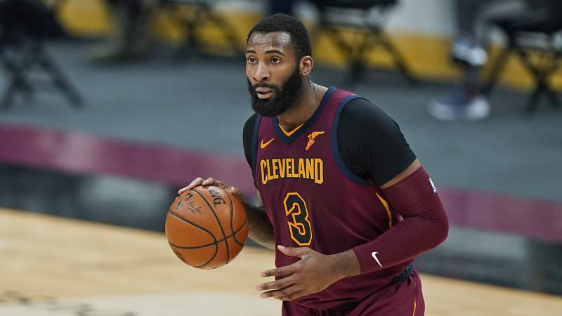 FILE - In this Feb 5, 2021, file photo, Cleveland Cavaliers' Andre Drummond drives the second half of an NBA basketball game against the Milwaukee Bucks in Cleveland. Drummond is now a free agent and can sign with a contending team after reaching a buyout with the Cavaliers. Drummond, who has not played since mid-February, began negotiating terms of the buyout with the Cavs on Thursday, March 25, 2021, after the club could not trade the 27-year-old. (AP Photo/Tony Dejak, File)