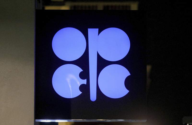 FILE - In this Dec. 19, 2019 file photo, the advertising label of the Organization of the Petroleum Exporting Countries, OPEC, shines at their headquarters in Vienna, Austria.  Leaders of the OPEC cartel are meeting virtually to decide how much oil their countries should produce as the coronavirus stifles demand for fuel. Theyre expected to extend production cuts into the new year in an effort to boost prices. (AP Photo/Ronald Zak, File)