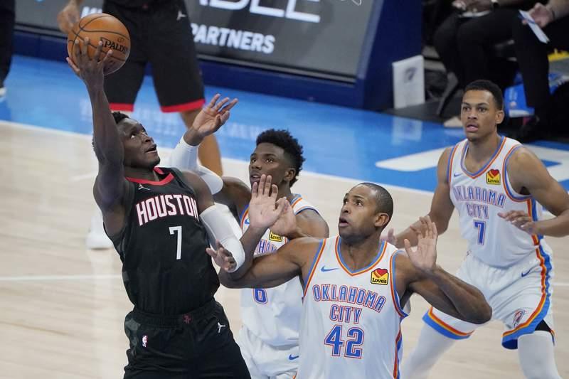 Houston Rockets guard Victor Oladipo (7) shoots in front of Oklahoma City Thunder guard Hamidou Diallo (6), center Al Horford (42) and forward Darius Bazley (7) in the second half of an NBA basketball game Wednesday, Feb. 3, 2021, in Oklahoma City. (AP Photo/Sue Ogrocki)