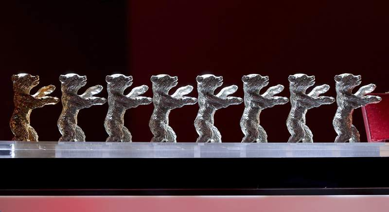 FILE - The Baeren (Bears) awards are lined up during the award ceremony for the 2020 Berlinale Film Festival in Berlin, Germany, on Feb. 29, 2020. Organizers say the annual Berlin International Film Festival is being put off this year due to the coronavirus pandemic and split into two parts later in 2021. (AP Photo/Michael Sohn, File)