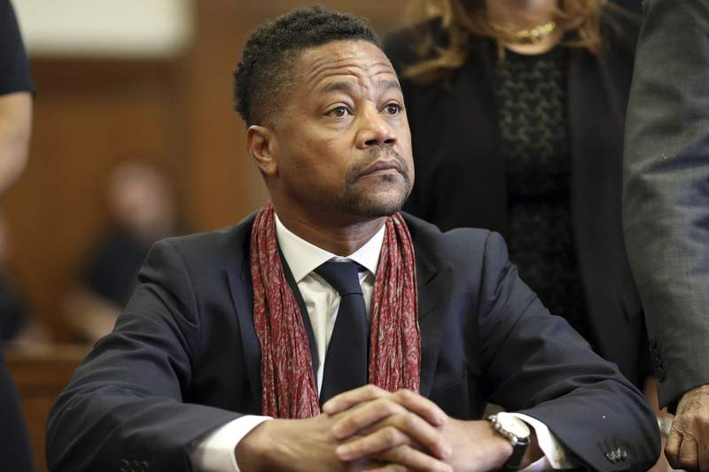 """FILE - In this Jan. 22, 2020, file photo, actor Cuba Gooding Jr. appears in court, in New York. Gooding is accused of raping a woman twice in a Manhattan hotel room in 2013, according to a lawsuit dated Monday, Aug. 17, 2020, but filed publicly Tuesday in Manhattan federal court. Attorney Mark Heller, who represents the 52-year-old actor, said the alleged event never took place."""" (Alec Tabak/The Daily News via AP, Pool, File)"""