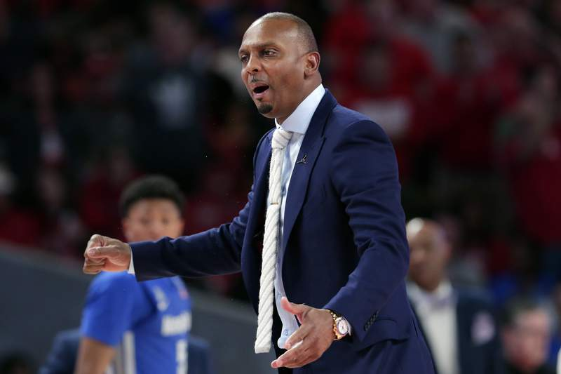"FILE - Memphis head coach Penny Hardaway questions a foul call during the second half of an NCAA college basketball game against Houston, Sunday, March 8, 2020, in Houston. As the NCAA gets set announce its plans for the 2020-21 college basketball season, there are clear precedents and blueprints in place should it decide to go the bubble route. Maybe do it for maybe a week or two at a time, playing a certain amount of games and getting retested after you come back or something like that, Memphis coach Penny Hardaway said. ""Its possible, its not going to be easy.(AP Photo/Michael Wyke, File)"