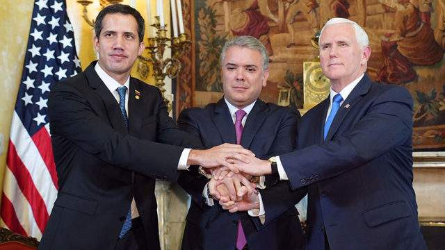 The U.S. Department of State released this photo on Monday showing U.S. Vice President Mike Pence and Colombian President Ivan Duque showing their support of Venezuelan opposition leader Juan Guaidó.