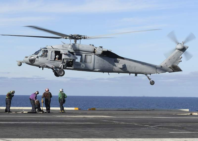 In this March 19, 2017, photo released by the U.S. Navy, an MH-60S Sea Hawk helicopter prepares to land on the flight deck of the aircraft carrier USS Nimitz in the Pacific Ocean. The Navy declared five missing sailors dead Saturday, Sept. 4, 2021, nearly a week after their helicopter, similar to the one pictured, crashed in the ocean off San Diego. (Mass Communication Specialist Seaman Ian Kinkead/U.S. Navy via AP)