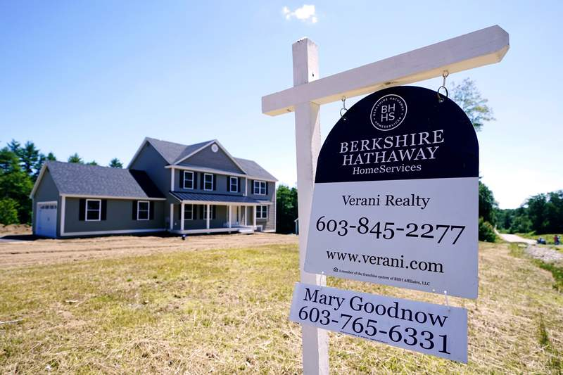 FILE - In this Thursday, June 24, 2021 file photo, a real estate sign is posted in front of a newly constructed single family home in Auburn, N.H. U.S. home prices registered the fastest growth in 17 years in May as a surge in demand for housing outstripped the supply. The S&P CoreLogic Case-Shiller 20-city home price index, released Tuesday, July 27 soared 17% in May from a year earlier on top of a 15% jump in April.  (AP Photo/Charles Krupa, File)