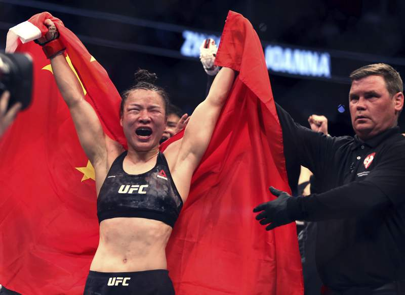 Zhang Weili celebrates her win by decision over Joanna Jedrzejczyk in the women's strawweight championship mixed martial arts bout at UFC 248 on Saturday, March 7, 2020, in Las Vegas. (L.E. Baskow/Las Vegas Review-Journal via AP)