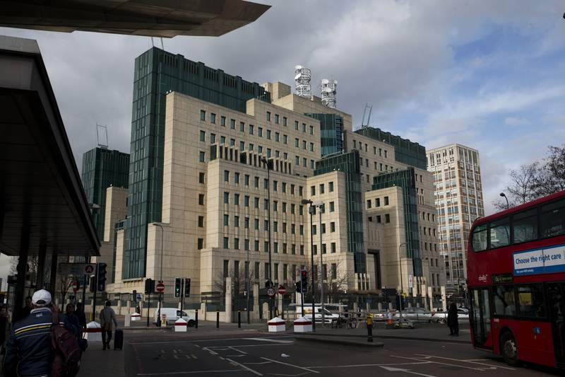 FILE - This Thursday, March 5, 2015 file photo shows a general view of the MI6 building in London. The head of Britains MI6 intelligence service, Richard Moore said in a video statement on Twitter, Friday Feb. 19, 2021, has apologized to gay spies and aspiring agents who were fired or denied jobs because of their sexuality.   (AP Photo/Matt Dunham, File)