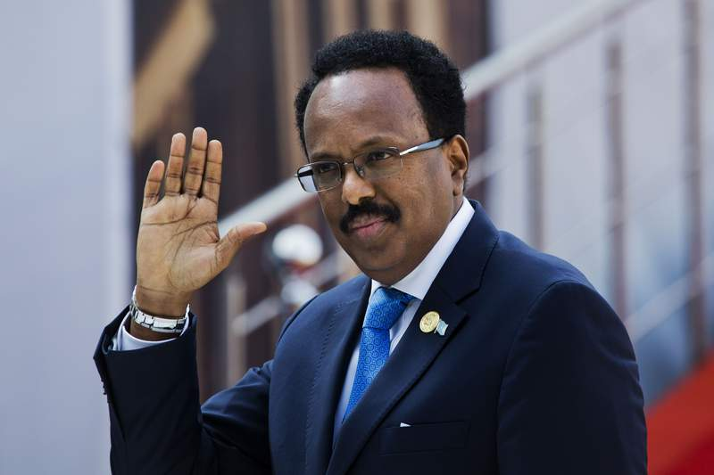 FILE - In this Saturday, May 25, 2019, file photo, Somalia's President Mohamed Abdullahi Mohamed arrives for the swearing-in ceremony of Cyril Ramaphosa at Loftus Versfeld stadium in Pretoria, South Africa. Somalia's parliament on Monday, April 12, 2021 voted to effectively extend the mandate of the president and federal government by two years in an attempt to end a political crisis after national elections were delayed in early February. (AP Photo/Jerome Delay, File)