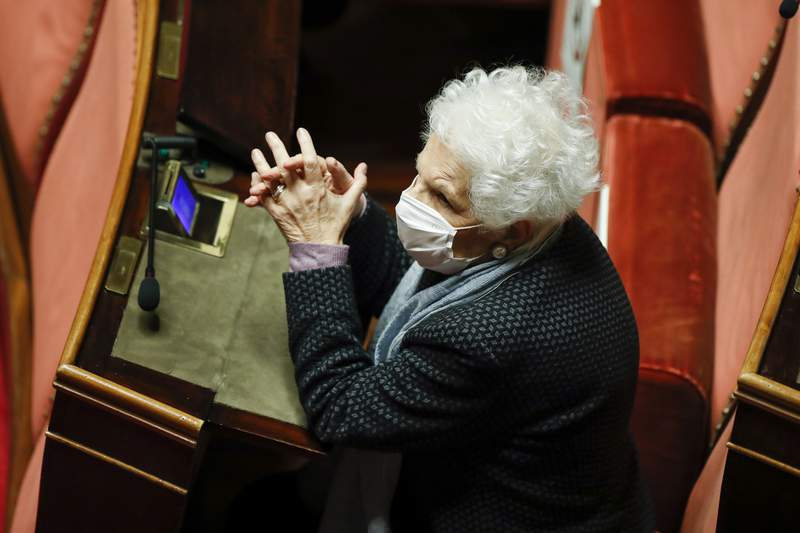 FILE - In this Jan. 19, 2021 file photo, 90-year-old Holocaust survivor Liliana Segre wears a face mask to curb the spread of COVD-19 as attends the debate at the Senate prior to a confidence vote, in Rome. On Friday, Feb. 19, 2021, Italian Interior Minister Luciana Lamorgese expressed solidarity and closeness to Segre and denounced the new and unacceptable attack she suffered on the (social media) network marked by a very dangerous mix of hate, violence and racism. Segre's efforts to encourage other older adults to receive the anti-COVID-19 vaccine as she did have triggered a wave of anti-Semitic comments and other invective on social media. (Yara Nardi/pool photo via AP, file)
