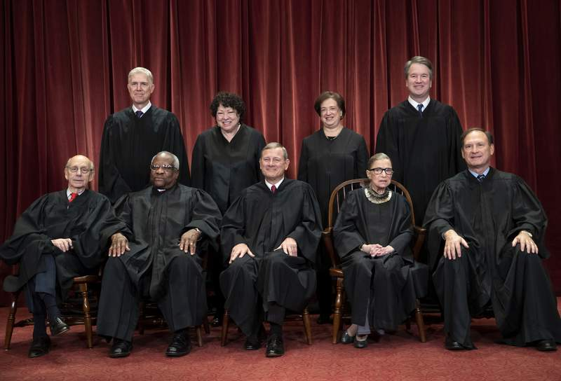 FILE - In this Nov. 30, 2018, file photo, the justices of the U.S. Supreme Court gather for a formal group portrait to include the new Associate Justice, top row, far right, at the Supreme Court building in Washington. Seated from left: Associate Justice Stephen Breyer, Associate Justice Clarence Thomas, Chief Justice of the United States John G. Roberts, Associate Justice Ruth Bader Ginsburg and Associate Justice Samuel Alito Jr. Standing behind from left: Associate Justice Neil Gorsuch, Associate Justice Sonia Sotomayor, Associate Justice Elena Kagan and Associate Justice Brett M. Kavanaugh. Its the time of the year when Supreme Court justices can get testy, but they might have to find a new way to show it. (AP Photo/J. Scott Applewhite, File)