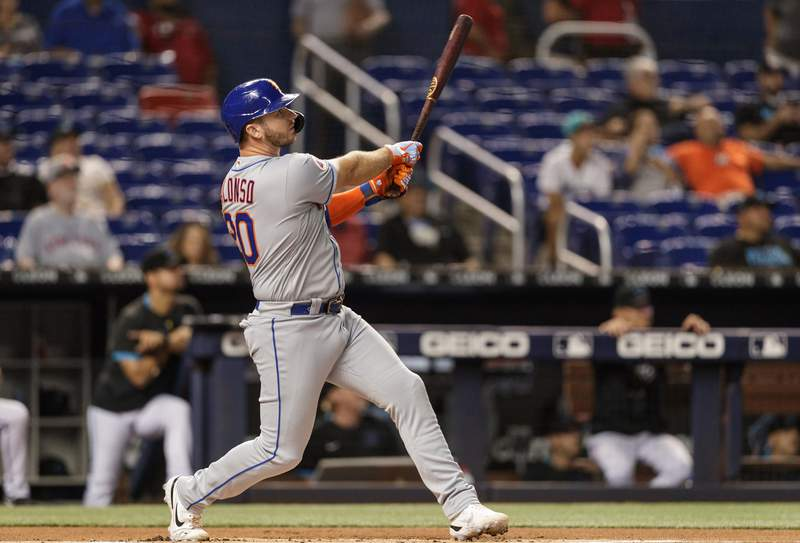Pete Alonso of the New York Mets watches the ball he hit leave the ballpark for a home run in the first inning against the Miami Marlins at loanDepot park on September 7, 2021 in Miami, Florida.