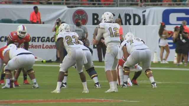FIU quarterback James Morgan prepares to take a snap against the Miami Hurricanes.